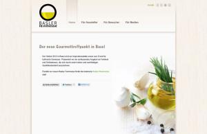 Homepage mit Ölfläschchen, Knoblauch und Teasertext